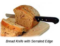 Bread Knife and Loaf of Bread