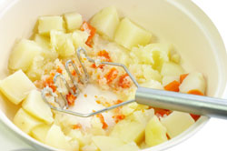Mashing Cooked Carrots and Potatoes