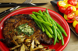CHILI-RUBBED RIB-EYE STEAKS WIH CILANTO BUTTER