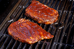 Steaks Raw on Grill