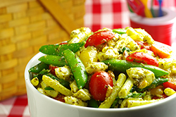 Green Bean, Snap Pea, and Pesto Salad with Cherry Tomatoes and Fresh Mozzarella
