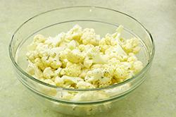 Tossing Cauliflower in Bowl