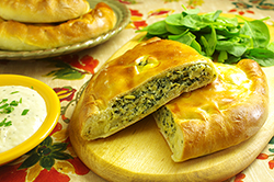 Spinach, Artichoke and Cheese Calzone with Roasted Garlic Dipping Sauce