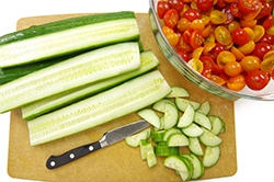 Prepping Cucumbers and Tomatoes