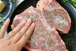 Rub steak with salt and pepper