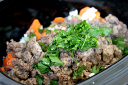 Add cooked sausage and parsley