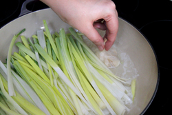 Add garlic to leeks