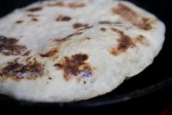 Cook pita in hot pan